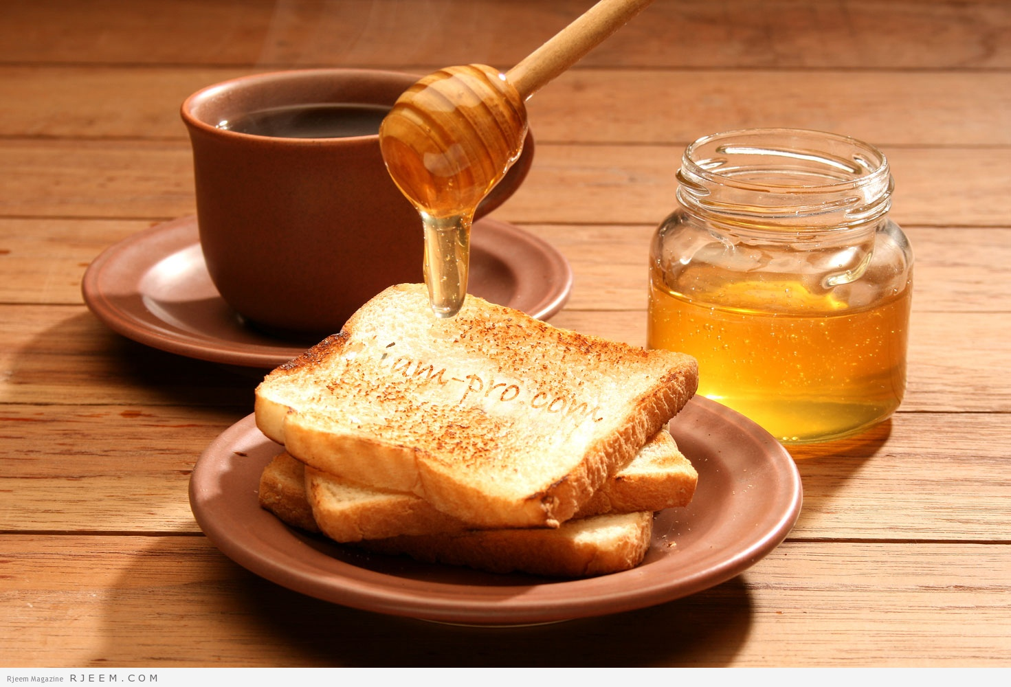 Breakfast scene. Honey pouring over toast bread