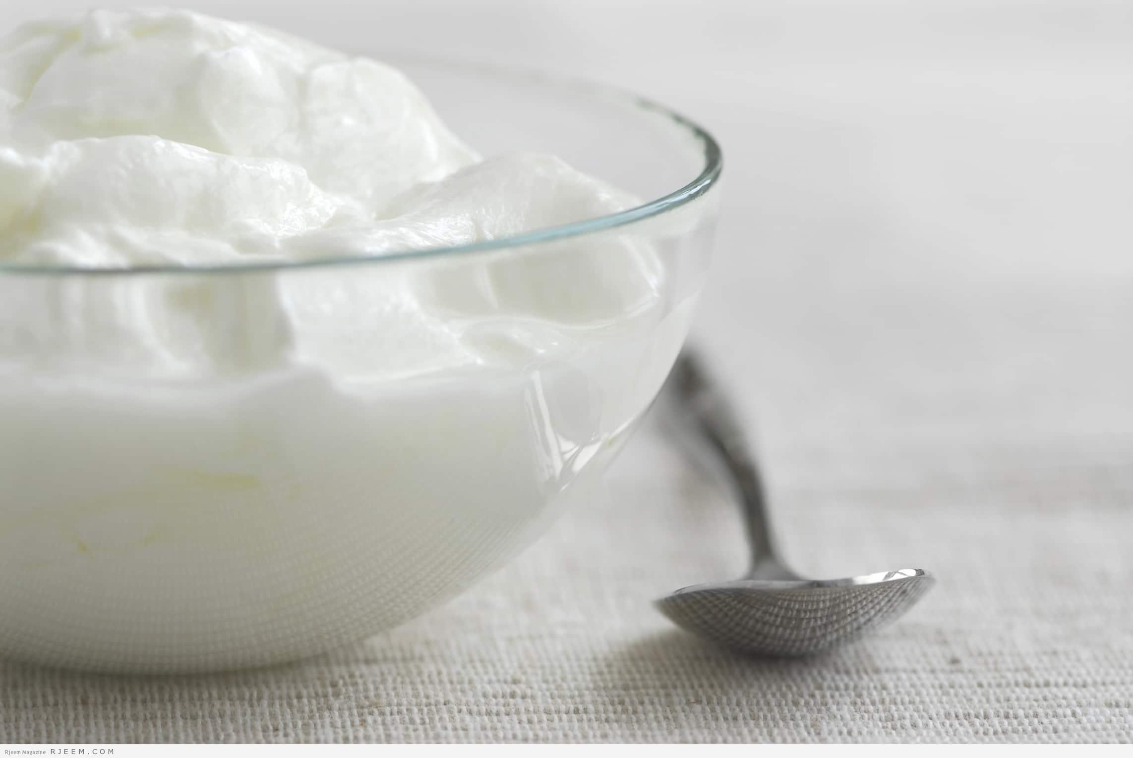 Fresh yogurt served in a clear glass bowl