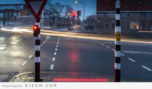 Photo of فيديو: مدينة هولندية تثبت إشارات مرور في الشوارع لمدمني الهواتف الذكية