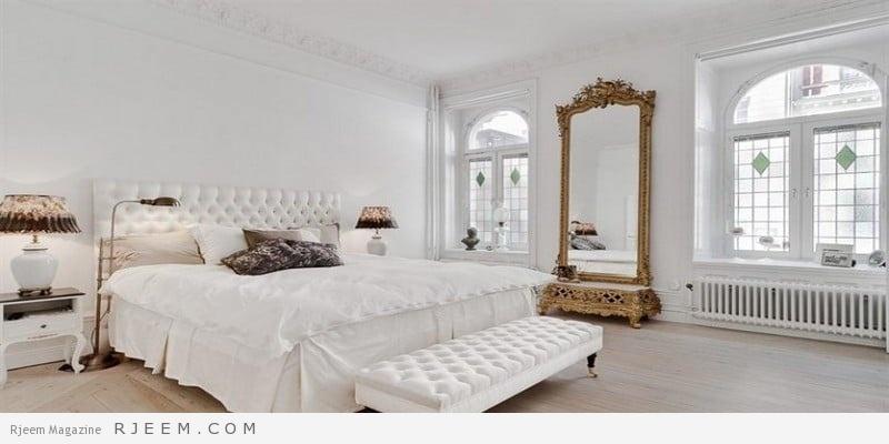 غرف نوم باللون الابيض مع مراية