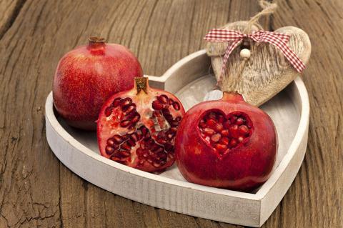 Pomegranates On A Wooden Tray